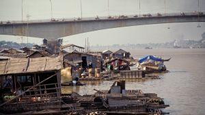 Floating houses under a bridge.