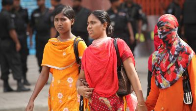 Women walking on the street in Dhaka, Bangladesh.
