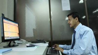 A stock trader in Bangladesh.
