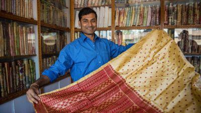A silk trader in Assam, India.
