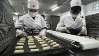 Production line at a rice cracker factory in Viet Nam.