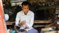Limbu working in his shop.